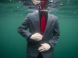 A Teenage Boy Swims in a Suit Along the Coast of Fernandina Island