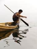 A Man Pulls in His Net on Indawgyi Lake  Northern Myanmar