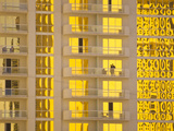 Sunlight Reflects Bright Gold on High Rise Casino Windows