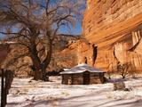A Navajo Hogan at the Base of the Canyon De Chelly Cliffs