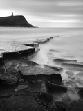 Rocks in Kimmeridge Bay with Clavell Tower in the Background  Dorset  UK