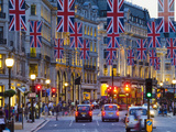 UK  England  London  Regent Street  Taxis and Union Jack Flags