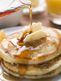 Pouring Maple Syrup over Pancakes with Dab of Butter Papier Photo