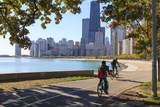 Cyclists Riding Along Lake Michigan Shore with the Chicago Skyline Beyond  Chicago  Illinois  USA