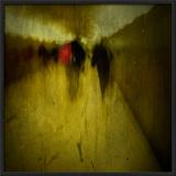 People Walking Along a Tunnel
