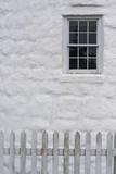 Close Up of Stone Masonry  Window  and White Picket Fence