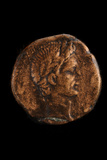 A Bronze Coin with the Profile of Roman Emperor Augustus