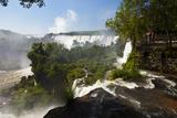 Tourists Stand on a Viewing Platform Overlooking Iguazu Falls