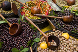 A Selection of Olives Sit in a Marketplace