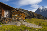 Swiss Alpine Homes Made of Stone Below Jungfrau Mountain Papier Photo par Jonathan Irish