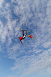 A Pro Kiteboarder Jumps High over the Pamlico Sound