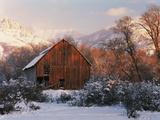Barn Below Bear River Range in Winter  Utah  USA