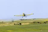 Crop Duster Airplane Spraying Farm Field Near Mott  North Dakota  USA