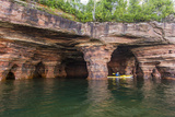 Kayaker in Sea Caves  Devils Island  Apostle Islands National Lakeshore  Wisconsin  USA