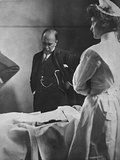 Sir William Osler Reading a Patient's Chart at Bedside as a Nurse Watches  Ca 1903