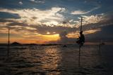A Stilt Fisherman at Sunset