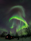 The Aurora Borealis Over a Sami Village House
