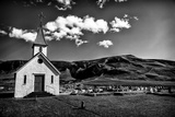 A Church and Cemetery in a Hilly Landscape with Puffy Clouds Papier Photo par Jonathan Irish