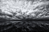 Heavy Dramatic Clouds and Their Reflection in Calm Water Papier Photo par Jonathan Irish