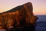 Sunlight Reflects on Neist Point Light on Cliffs Above the Atlantic