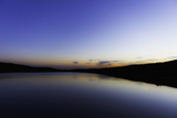 Reflections in a Calm Lake at Twilight Papier Photo par Jonathan Irish