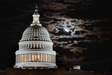 The Full Moon Rises Behind the United States Capitol Building