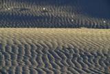 Reflections of Sunlight in Gypsum Sand Dunes