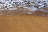 Gentle Ocean Surf Surging Onto a Golden Sand Beach