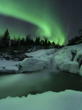 A Wintery Waterfall And Aurora Borealis Over Tennevik River  Norway