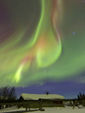 Aurora Borealis And Orion's Belt Above a Log Cabin at Whitehorse  Yukon  Canada