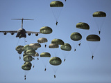 US Army Paratroopers Jumping Out of a C-17 Globemaster III Aircraft