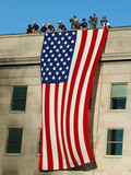 Fire And Rescue Workers Unfurl a Huge American Flag Over the Side of the Pentagon