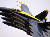 Four Blue Angels F/A-18C Hornets Perform the Echelon Parade Maneuver
