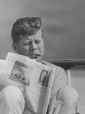 President John F Kennedy Smoking a Cigar And Reading the Newspaper