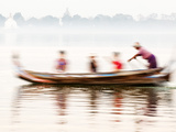 boatman Taking Tourists in Traditional Boat Across Taungthaman Lake  Amarapura  Burma (Myanmar)