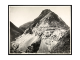 View of Two Railroad Trains on Tracks Along a Mountain  Presumably on or Near the Panama Canal …