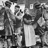 French Peasants Greet Two Heavily-Laden Americans  1917