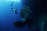 Diver by Shipwreck's Propeller