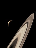 Titan's Lakes And Saturn's Rings