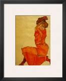Kneeling Female in Orange Dress  c1910