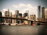 Skyline of NYC with One World Trade Center and East River  Manhattan and Brooklyn Bridge  Vintage