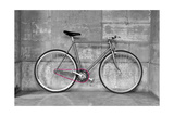 A Fixed-Gear Bicycle (Or Fixie) In Black And White With A Pink Chain