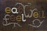 The Phrase 'Eat Well  Be Well'  Written And Decorated In Seeds