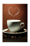 Cup Of Coffee With Smoke In Shape Of Heart On Brown Background