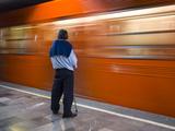 A Mexican Citizen Waits for the Metro to Stop  Mexico City  Mexico