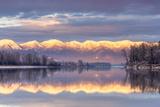 Swan Mountains Reflect into the Flathead River  Sunset  Montana  USA