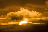 Sun Rising Through the Clouds at Dawn  ANWR  Alaska  USA