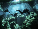 Diver Enters the Cavern System in the Riviera Maya Area of Mexico
