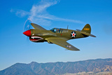 A Curtiss P-40E Warhawk in Flight Near Chino  California