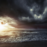 Bright Sunset Against a Wavy Sea with Stormy Clouds  Hersonissos  Crete